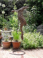 Larger than life size, Willow Boxing Hare on spiral.