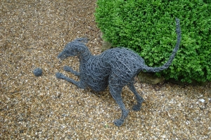 Whippet dog playing, life size, wire and steel