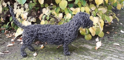 Wire haired Dachshund 'Bert' a life size patinated wire sculpture.