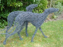 Whippet dog sculptures.
