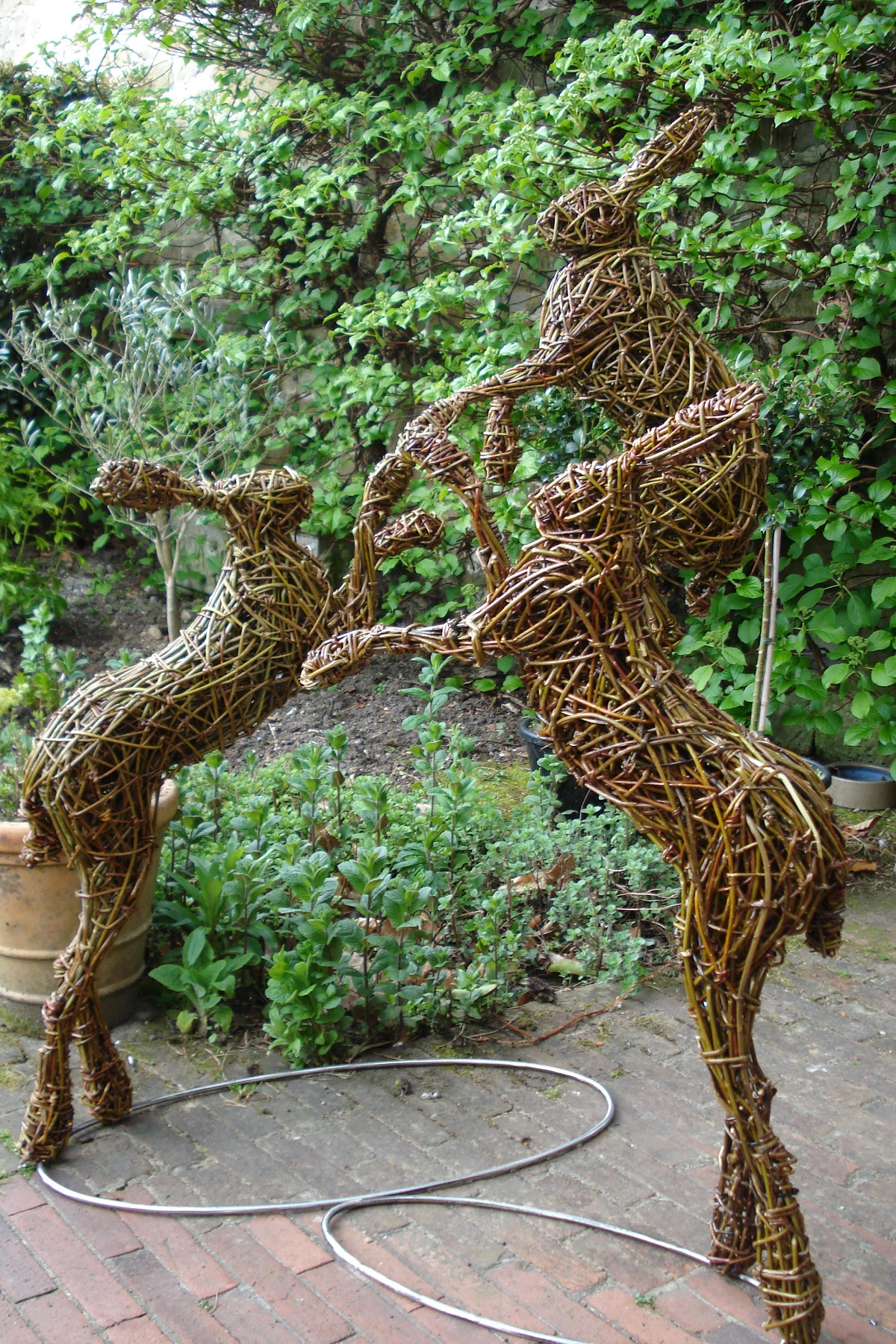 willow hares boxing , garden hares boxing sculptures