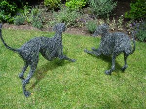 Playing Whippet Dogs, life size, painted wire.