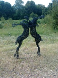Boxing Hares, life size, painted wire.