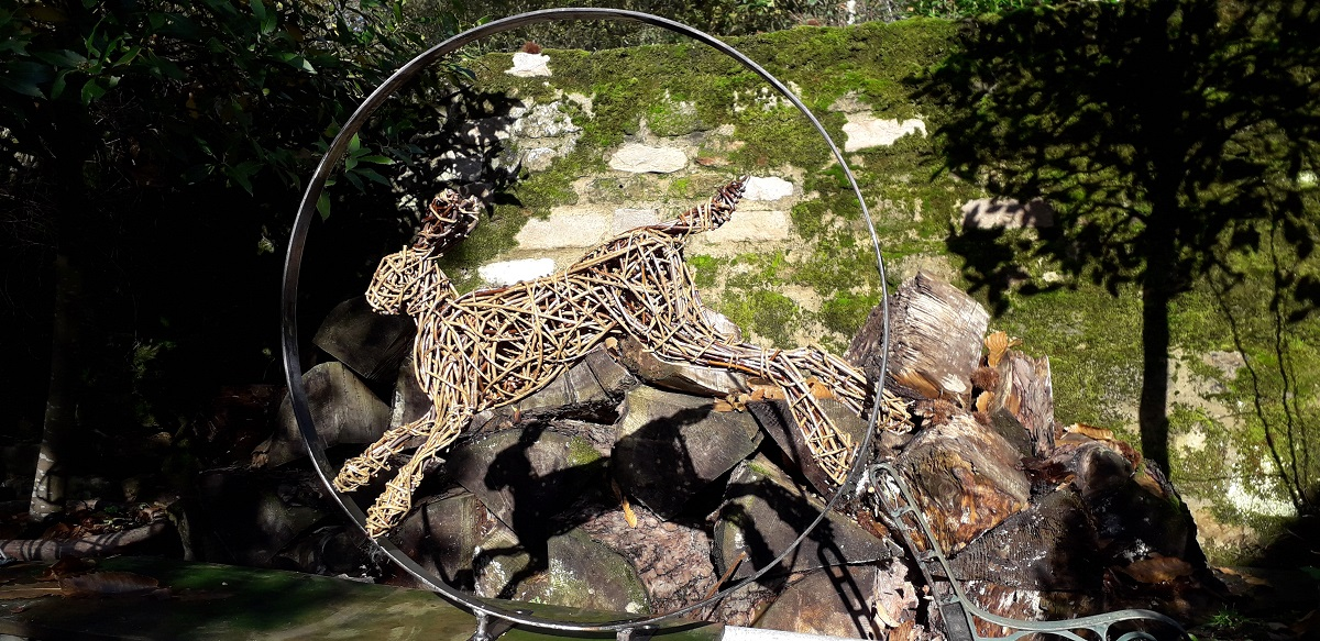 hare leaping in willow, hare sculpture for garden in willow and steel